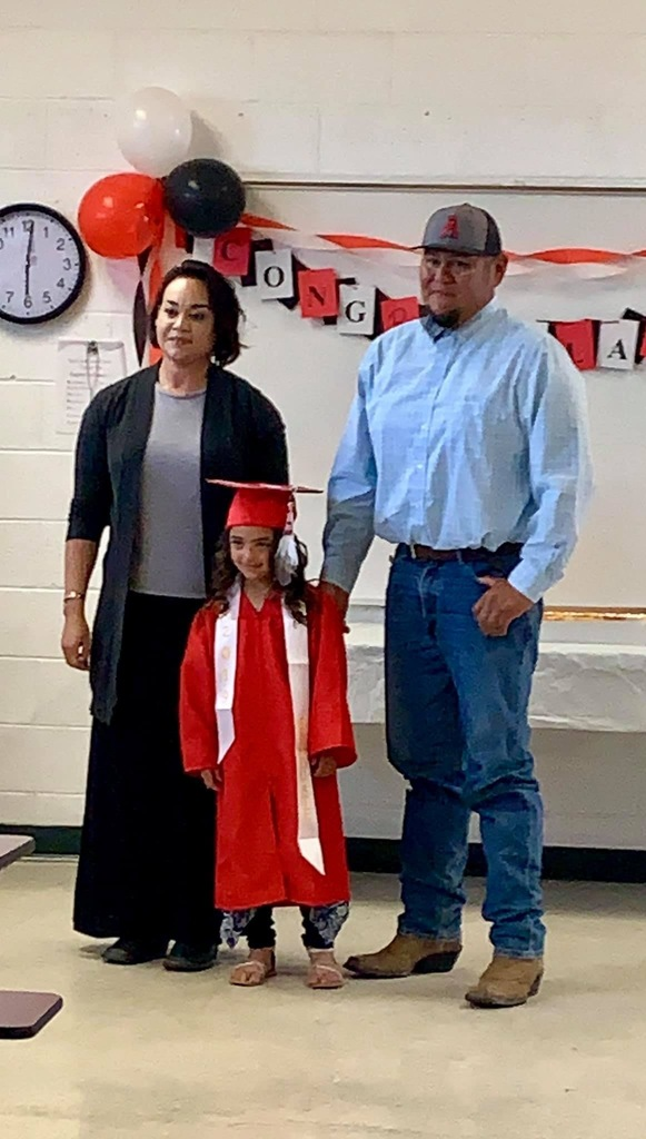 Proud parents with their graduate!