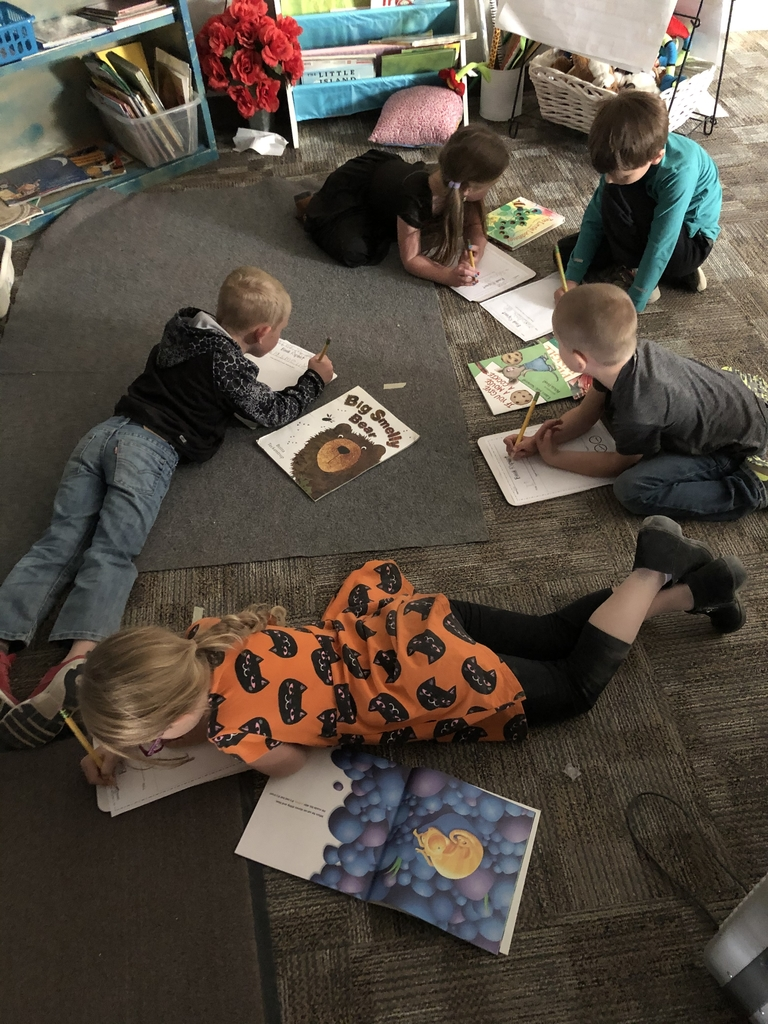 Kindergarten working on a book report.